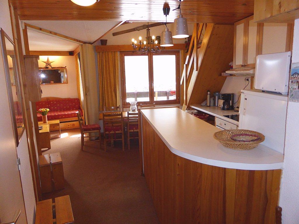 Foto van de keuken met bar van appartement Clairière 35