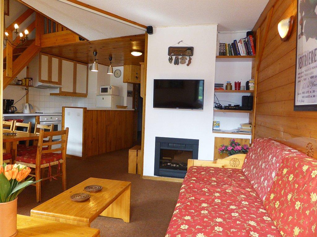 Foto van de woonkamer met open keuken van appartement Clairière 35