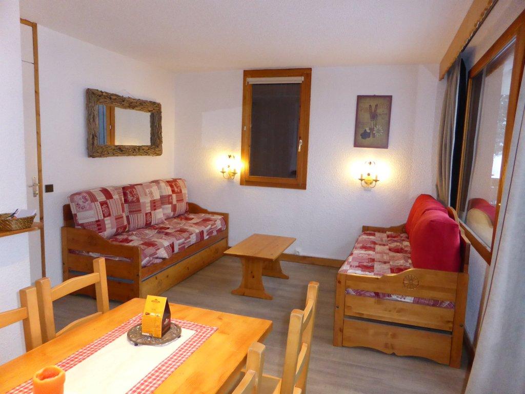 Foto van de zitkamer van appartement Souche 16